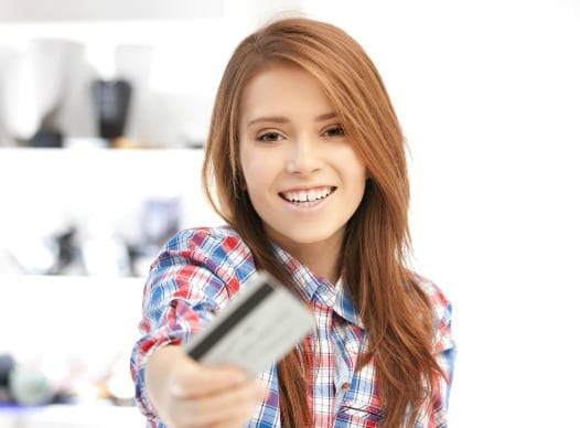 Young woman with credit card