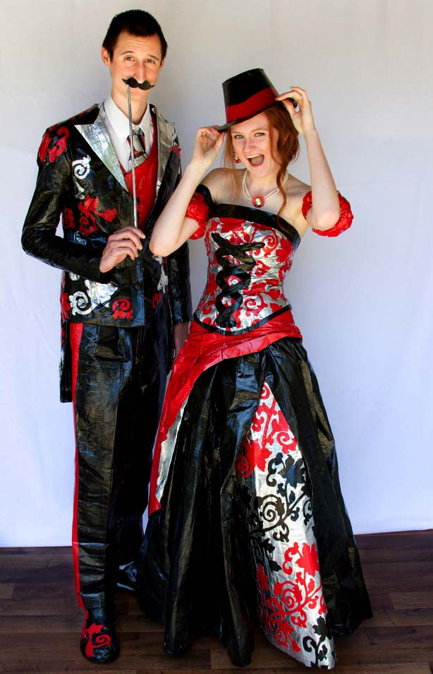 Couple wearing prom dress and tuxedo made of duct tape