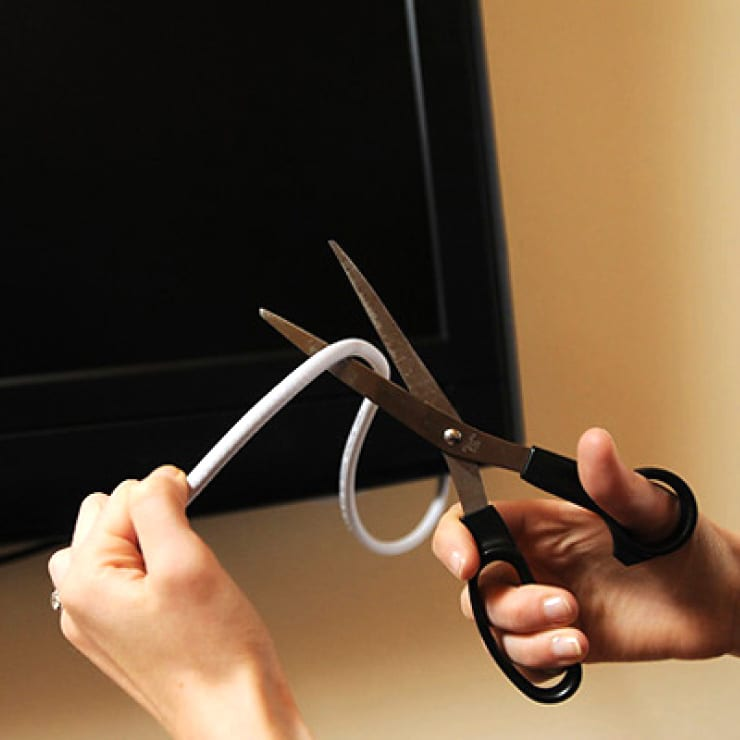 Scissors cutting a cable cord