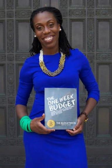 Budgetnista Tiffany Aliche holding her book