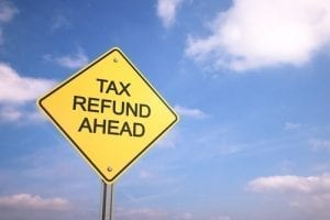 road sign with tax refund written on it