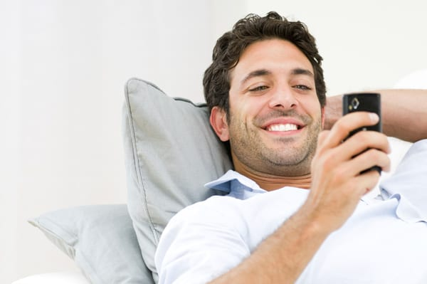 Happy man with a new cellphone.