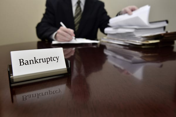 Man Filing Papers For Bankruptcy