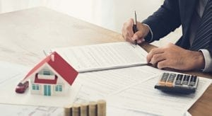 Man filling out paperwork - Home Equity Loan