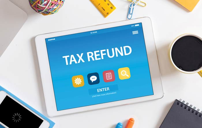 Tablet Screen with Tax Refund displayed on it