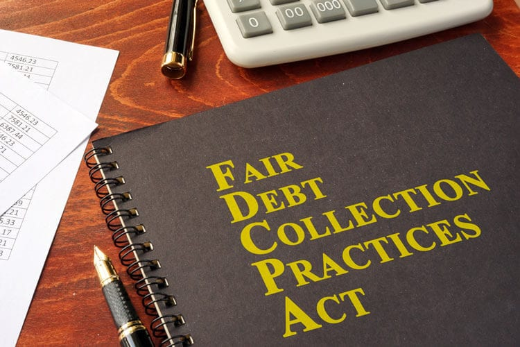FDCPA Fair Debt Collection Practices Act book on a table