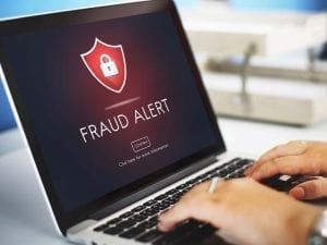 Fraud Alert on a computer front of man