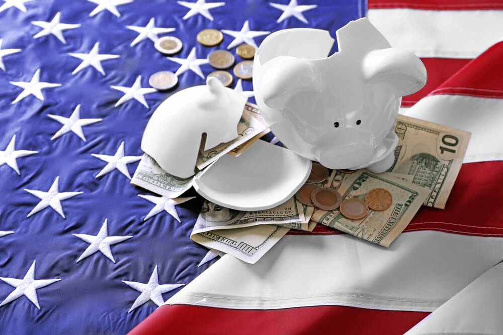 Piggy bank and money on American flag