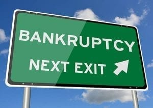 Highway exit sign with arrow to bankruptcy