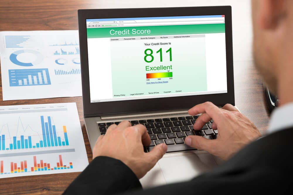 Desktop computer showing a credit score over 800