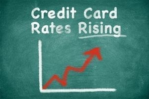 Chalkboard with graph of rising credit card rates