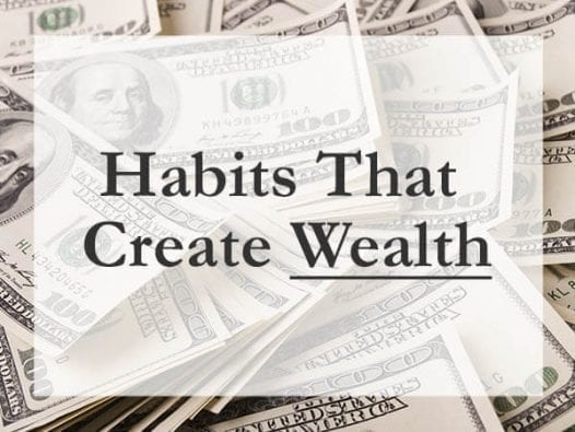 Sign that says habits that create wealth with money background