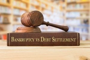"Law book titled ""Bankruptcy vs Debt Settlement"""