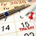 Calendar with July 15 marked as tax day