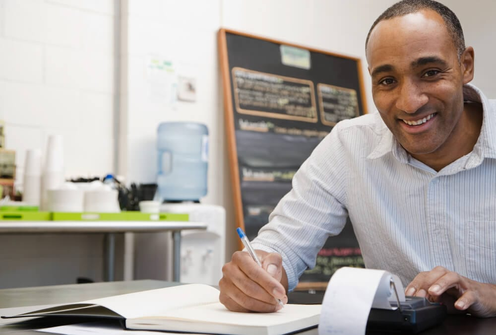 Businessman doing finances in his own small business