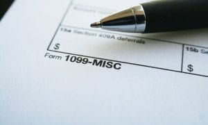 "Close up of form labeled ""1099-MISC"" with a pen sitting atop it"