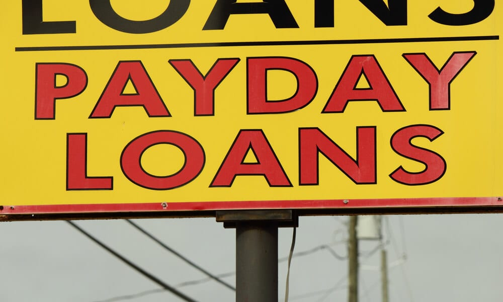 Roadside sign that says Payday Loans