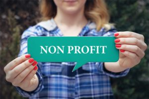 Woman holding nonprofit sign